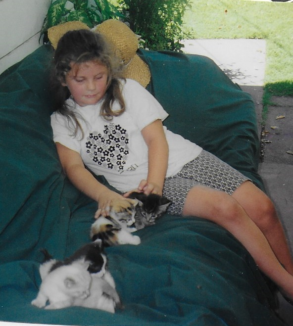 Taylor with kittens at grandma's house
